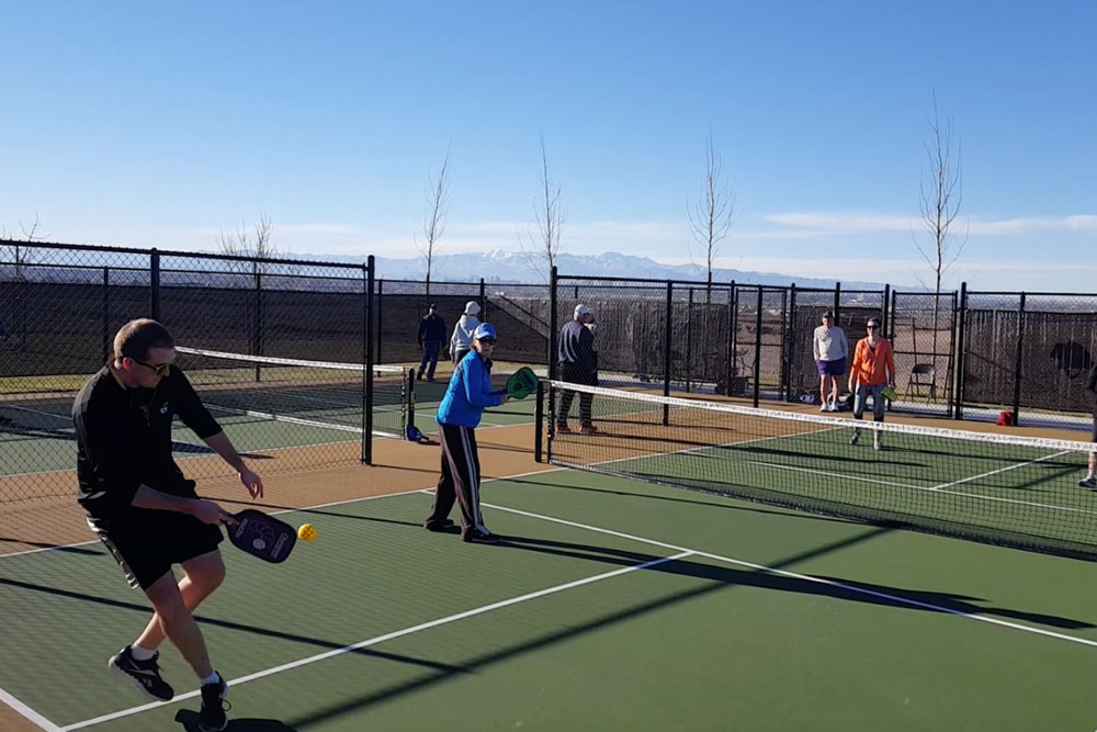 Cadence residents playing pickleball at the local sport courts